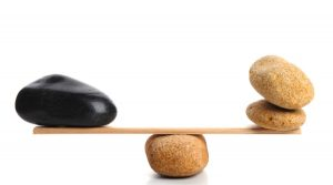 Stones balanced on a board on top of another rock