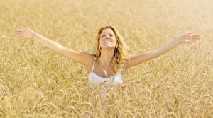 A woman in a field of wheat
